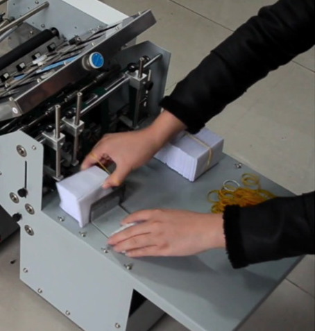 Stacker for small folded paper